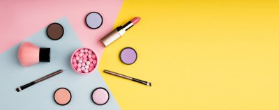 Poster Makeup products and decorative cosmetics on color background flat lay. Fashion and beauty blogging concept. Long web format for banner
