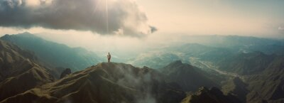 Poster Man standing on mountain top
