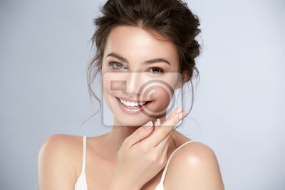 Poster model with perfect smile and beautiful face isolated on grey