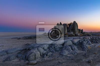 Monolith rocks after sunset at Kubu Island