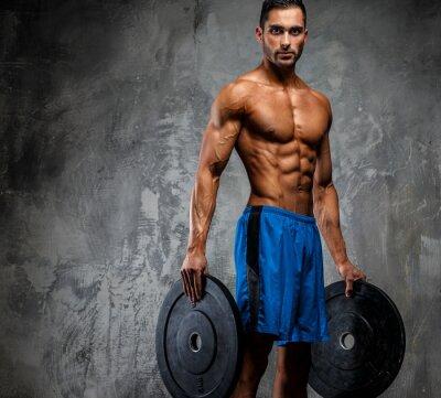 Poster Muskulöse Mann in blauen Shorts