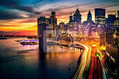 Poster Must see when visiting New York City. View of Lower Manhattan and  Brooklyn at sunset. Night scene. Light trails. City lights. Urban living, travel, real estate  and transportation concept