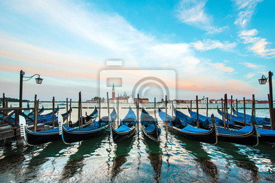 Mystical landscape with gondolas on the Grand Canal on the background of  Church of San Giorgio Maggiore in Venice, Italy, Europe.
