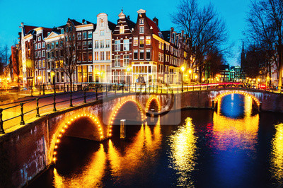 Night view of canals and bridges in Amsterdam, Netherlands