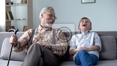 Poster Old man and boy laughing genuinely, joking, valuable fun moments together