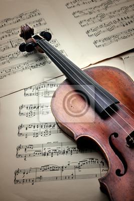 Old zerkratzt Violine auf Musikblatt. Vintage-Stil.