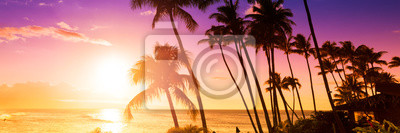 Poster Palm tree silhouette on a background of tropical sunset