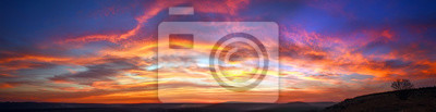 Poster Panorama colorful magnificent sunset in countryside above hills and fields, beauty nature background