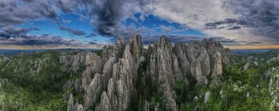 Poster panorama of needles spires with storm clouds in the background off needles highway in black hills of South Dakota
