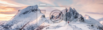 Poster Panorama of Steep peak mountains with covered snow and mountaineer man backpacker