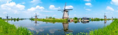 Poster Panorama of the windmills and the reflection on water in Kinderdijk, a UNESCO World Heritage site in Rotterdam, Netherlands