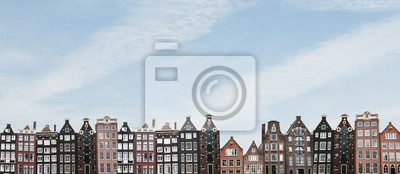 Poster Panorama or panoramic view. Traditional houses in Amsterdam in the Netherlands in a row against the blue sky.