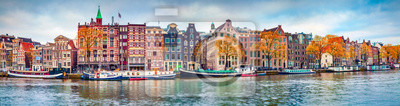 Poster Panoramic autumn view of Amsterdam city. Famous Dutch channels and great cityscape. Colorful morning scene of Netherlands, Europe. Traveling concept background.