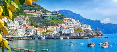 Poster Panoramic view of beautiful Amalfi on hills leading down to coast, Campania, Italy. Amalfi coast is most popular travel and holiday destination in Europe.
