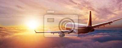 Poster Passengers commercial airplane flying above clouds