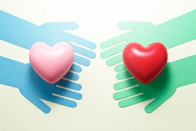 Poster People helping each other. Compassion relationship image. Green hands and blue hands giving hearts each other.