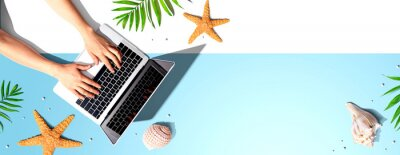 Poster Person using a laptop computer with summer theme objects