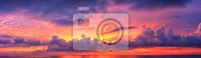 Poster Phuket beach sunset, colorful cloudy twilight sky reflecting on the sand gazing at the Indian Ocean, Thailand, Asia.