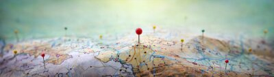 Poster Pins on a geographic map curved like mountains. Pinning a location on a map with mountains. Adventure,  geography, mountaineering, hike and travel concept background.