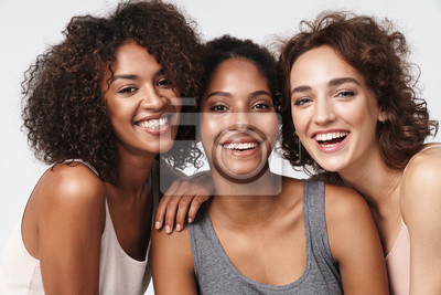 Poster Portrait of young multiracial women standing together and smiling