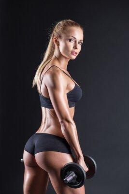Poster Portrait von einem schönen Mädchen Athlet mit einer Hantel in Studio