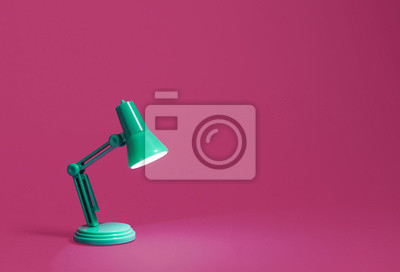 Poster Retro green desk lamp turned on and bent over shining on a bright pink background.  Landscape orientation with a left side composition leaving room for text and copy space.