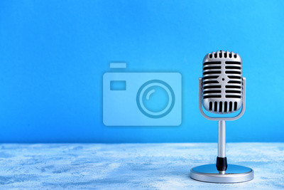 Poster Retro microphone on table against color background