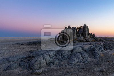 Rock monolith at pink and blue sunset colors