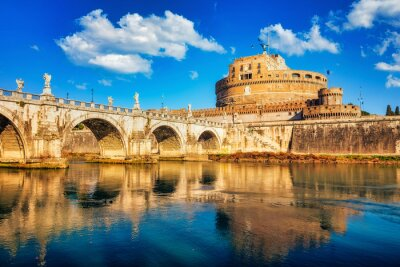 Saint Angel Castle and bridge over the Tiber river in Rome at sunny day