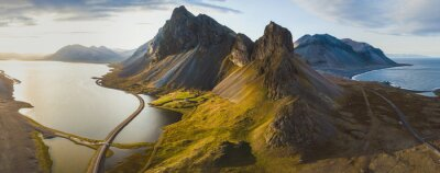 Poster scenic road in Iceland, beautiful nature landscape aerial panorama, mountains and coast at sunset