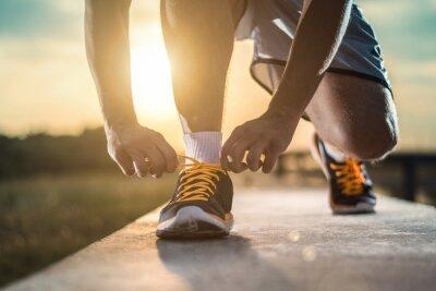 Poster Schließen Sie herauf Schuß der Schuhe des Läufers