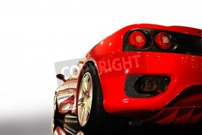 Poster  shot  of a  red sports car (ferrari)
