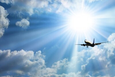 Poster Silhouette of airplane with a beautiful sky
