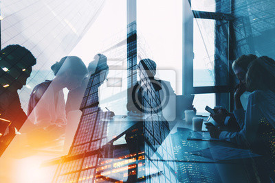 Poster Silhouette of business people work together in office. Concept of teamwork and partnership. double exposure with light effects