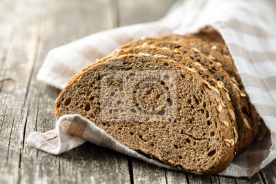 Poster Sliced whole grain bread with oat flakes. Wholemeal bread.
