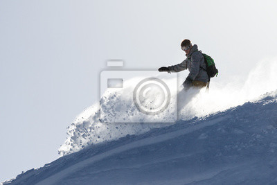 Snowboarder is having fun in the backcountry powder in the Italian Alps