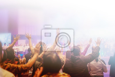 Poster Soft focus of Christian worship with raised hand,m