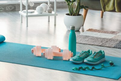 Poster Sports equipment on yoga mat at home