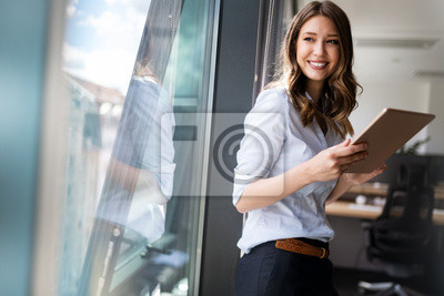 Poster Successful business woman looking confident and smiling