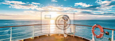 Poster Summer cruise vacation concept. Panoramic view of the sea with a beautiful sunset just above the horizon.