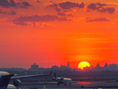 Poster Sunset at the airport with airplanes ready to take off