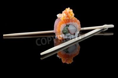 Poster sushi with chopsticks over black background