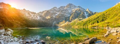 Poster Tatra National Park, a lake in the mountains at the dawn of the sun. Poland