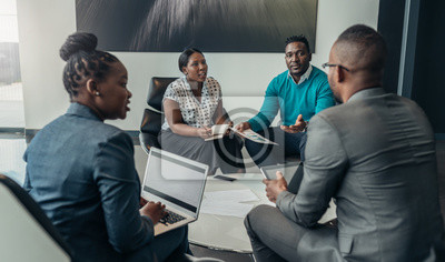 Poster Team of african bussines people debating during a work meeting. Colleagues in serious discussions