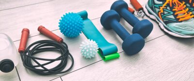 Poster The fitness tools and  a equipment on the wooden floor. Concept of home physical training and staying at home