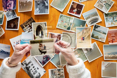 Poster Top view of a senior caucasian woman looking at an old photos themes of memories nostalgia photos retired