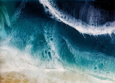 Poster Top view on sea wave with white foam and light beige sand. drawing with epoxy resin. Close-up of deep rich blue, azure, turquoise color of water, shore. Trendy painting for background