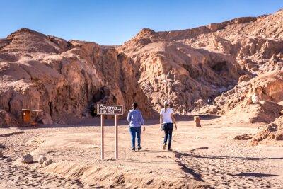 Tourist walking into Atacama's Caverna de Sal (salt cave) attraction in Chile