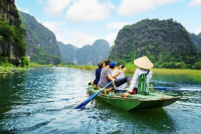 Poster Touristen machen Bild. Rower mit ihren Füßen zu rudern Ruder