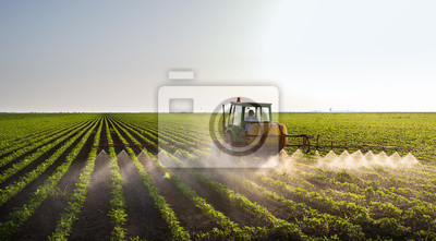 Poster Tractor spraying soybean field